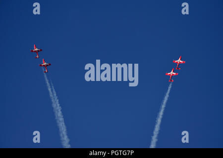 Four members of the Canadian Forces 431 Air Demonstration Squadron executing a manuver at an air show over the Nanaimo harbour on Vancouver Island Bri - Stock Photo