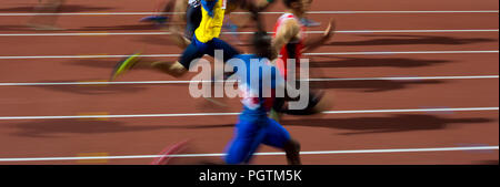 running men sprinters runners in 100 meters blurred motion - Stock Photo