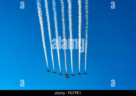 Canadian Forces (CF) Snowbirds, 431 Air Demonstration Squadron fly over Vancouver, British Columbia, Canada - Stock Photo