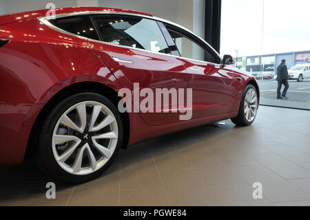 AUCKLAND - AUG 28 2018:The plug-in electric car Model 3, a mid-size / compact executive luxury four-door sedan manufactured and sold by Tesla, Inc. - Stock Photo