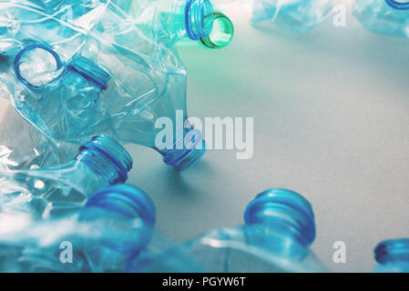 Crushed plastic bottles heap ready for recycling - Stock Photo
