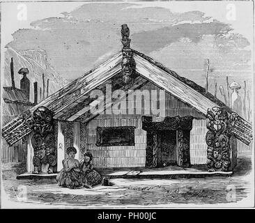 Black and white vintage print, depicting Maori Chief Rangihaeata's whare whakairo (carved meeting house) known as 'Kai-tangata, ' with carved posts, lintels, and gables, and two figures wearing flax skirts seated at the edge of the porch, and with the Pa (fortified settlement) fence visible in the background, located in New Zealand, published in John George Wood's volume 'The uncivilized races of men in all countries of the world, being a comprehensive account of their manners and customs, and of their physical, social, mental, moral and religious characteristics', 1877. Courtesy Internet Arch - Stock Photo