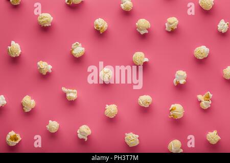 popcorn on a pink background - Stock Photo