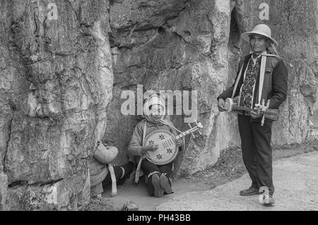 Shilin, Yunnan, China - 31 December 2017: A traditional chinese music band in the Stone Forest - Stock Photo
