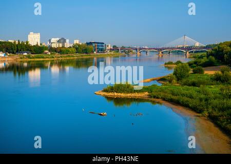 Warsaw, Mazovia / Poland - 2018/08/30: Panoramic view of the Poniatowskiego bridge and Swietokrzyski bridge across the Vistula river with Warsaw city  - Stock Photo