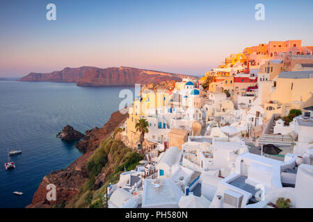 Oia, Santorini. Image of famous village Oia located at one of Cyclades island of Santorini, South Aegean, Greece. - Stock Photo