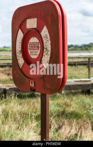 Close up of an emergency life ring in its case on a post along the river bank of the River Wyre in Lancashire, England, UK - Stock Photo