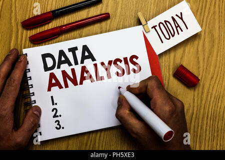Handwriting text writing Data Analysis. Concept meaning Translate numbers to Analytical Conclusion Forecasting Man holding marker notebook clothespin  - Stock Photo