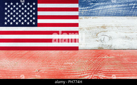American flag with national colors painted on fading wooden boards - Stock Photo