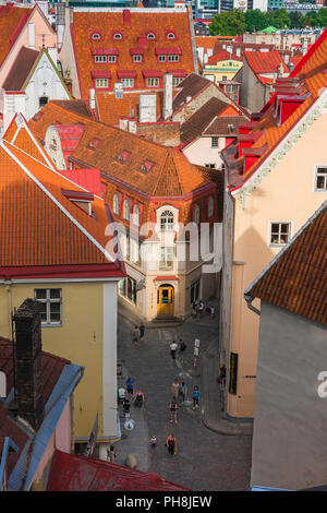 Tallinn street, view over orange tiled roofs towards a narrow street in the medieval Old Town quarter of Tallinn, Estonia. - Stock Photo