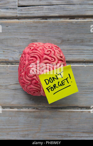 Don't forget label stuck on a brain - Stock Photo