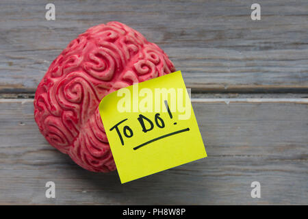 To do label stuck on a brain - Stock Photo