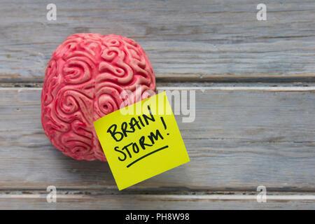 Brainstom label stuck on a brain - Stock Photo