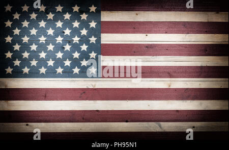 fading USA flag painted on faded wooden boards - Stock Photo