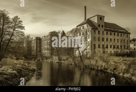 Dilapidatedly - old company ruin from GDR times - Stock Photo