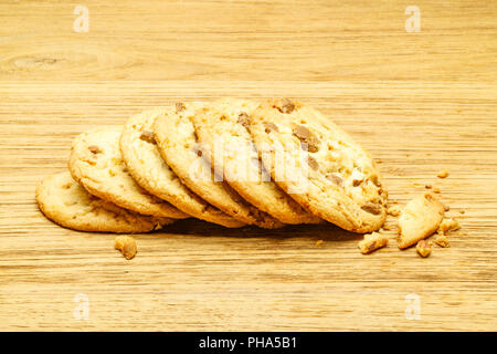 Milk chocolate almond cookies on a wooden board - Stock Photo