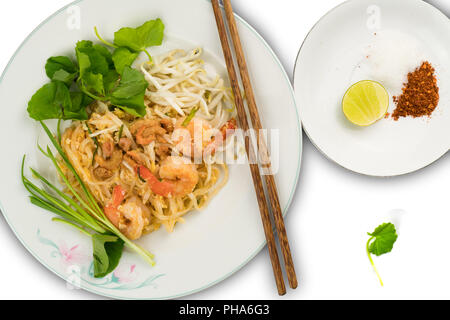 Thai style stir fried rice noodles with shrimps and vegetables - Stock Photo
