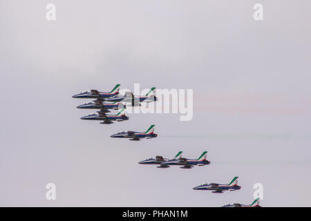 Aerobatic team performs flight, Planes flying in formation, Air show - Stock Photo