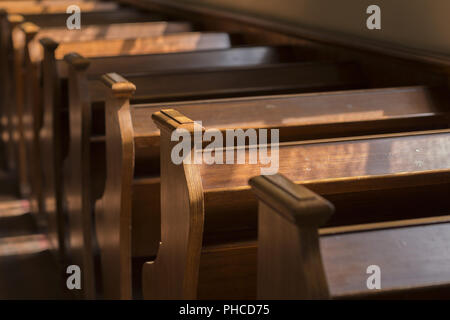 Pews in an old church - Stock Photo