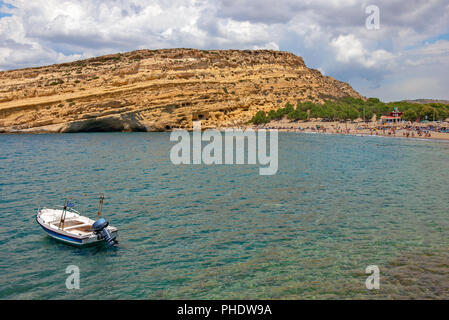 Matala beach and caves on rocks. Crete island. Greece - Stock Photo