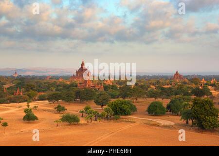 Temples in Bagan at sunrise, Myanmar - Stock Photo