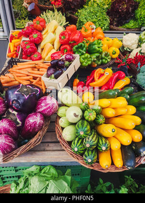 top down view on colorful vegetables on a market - Stock Photo