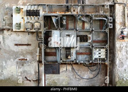 Fuse box on the site of an abandoned factory in Magdeburg - Stock Photo
