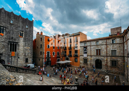 Girona, Spain - July 9, 2018: Tourists at Cathedral staircase and square, Placa de la Catedral, in Old Town of Girona in Catalonia, Spain - Stock Photo