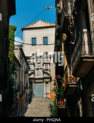 Girona, Spain - July 9, 2018: Pujada de Sant Domenec, located in the Old Town, is one of the most emblematic places of the city of Girona - Stock Photo
