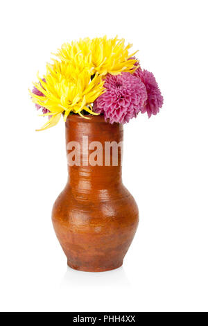 Big clay jug with dahlias flowers isolated on white background - Stock Photo