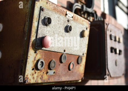 Emergency stop switch on a disused plant in the port of Magdeburg Magdeburg - Stock Photo