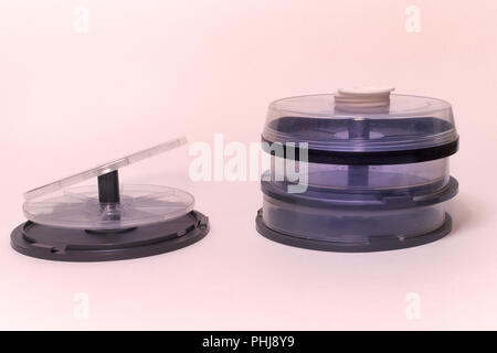 cd cake box. empty storage for keeping CDs DVDs BD on spindel - Stock Photo