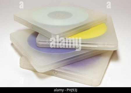 translucent cases with disks. Stack of multicolored MIDI-discs in regular double plastic boxes with lock. closeup - Stock Photo