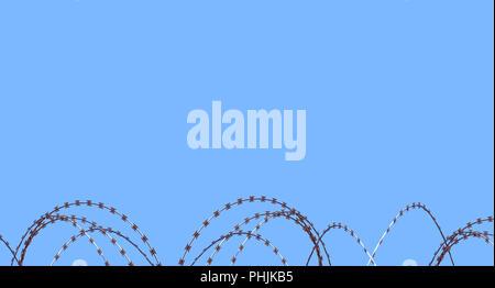 Barb razor wire against blue sky - Stock Photo