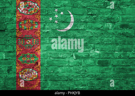 Flag of Turkmenistan over an old brick wall background, surface - Stock Photo