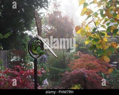 Foggy garden in autumn - Stock Photo