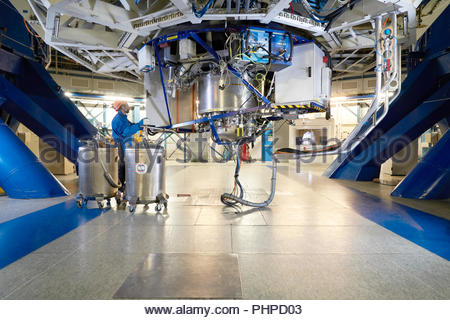 Astronomer adjusting machinery at Paranal Observatory in Chile - Stock Photo