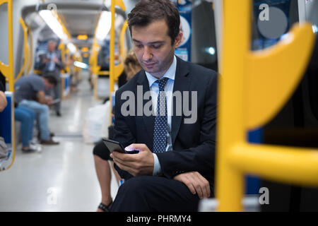 Commuter on underground is going to work - Stock Photo