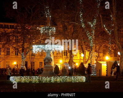 Water fountain decorated with Christmas lights as part of 'Advent in Zagreb', located on Zrinski square, Zagreb, Croatia. - Stock Photo