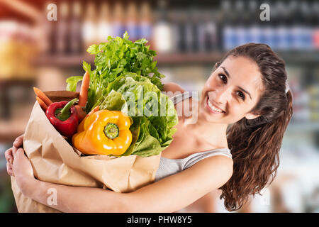 Bio shopping concept with girl at the super market with - Stock Photo