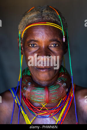 Mungambue tribe woman with the traditional hairtsyle and necklace, Huila Province, Chibia, Angola - Stock Photo