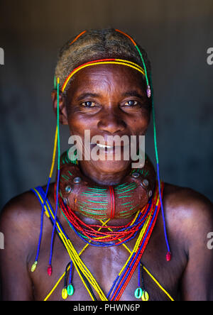 Smiling mungambue tribe woman with the traditional hairtsyle and necklace, Huila Province, Chibia, Angola - Stock Photo