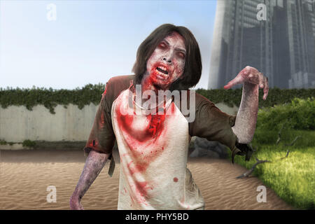 Spooky zombie man with ripped clothes walk around on abandoned city. Halloween concept - Stock Photo