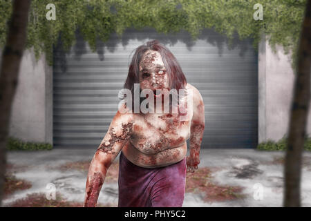 Terrible zombie man with bloody mouth hang around on abandoned city - Stock Photo
