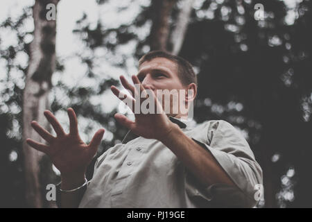Man moving in nature forest - Stock Photo