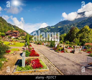 Colorful summer view of Lauterbrunnen village cemetery. Beautiful outdoor scene in Swiss Alps, Bernese Oberland in the canton of Bern, Switzerland. - Stock Photo
