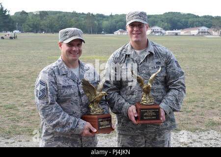 Senior Master Sgt. Jeremy Wohlford, Michigan Air National Guard Senior Non-Commissioned Officer of the Year for 2017-2018, and Tech. Sgt. Justin Smith, Michigan Air National Guard Non-Commissioned Officer of the Year for 2017-2018, were honored at the Michigan National Guard's annual Memorial Pass and Review, Camp Grayling Joint Maneuver Training Center, Mich., Aug. 24, 2018. Both are assigned to Alpena Combat Readiness Training Center, Mich. (Air National Guard photo by 1st Lt. Andrew Layton/released). - Stock Photo