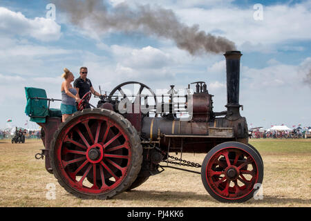 Traction engine at a steam fair in England - Stock Photo