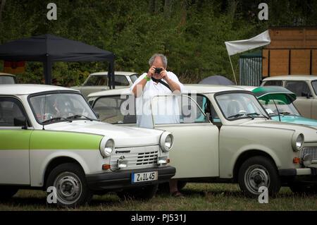 Man taking a photograph at Zwickau Trabant Club annual rally at Zwickau, Saxony, Germany - Stock Photo