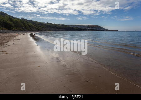 Looking across the bay towards the seaside town of Newquay in Wales and its harbour - Stock Photo